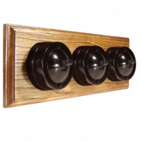 3 Gang Horizontal Bakelite Switch Brown Dolly On A Solid Medium Oak Base