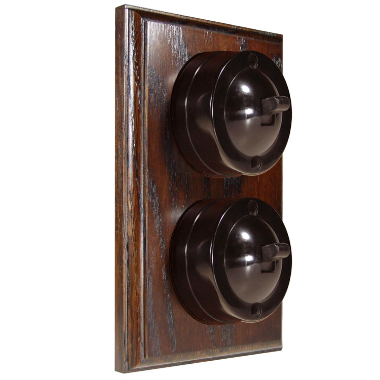 2 Gang Vertical Bakelite Switch, Brown Dolly On A Solid Dark Oak Base
