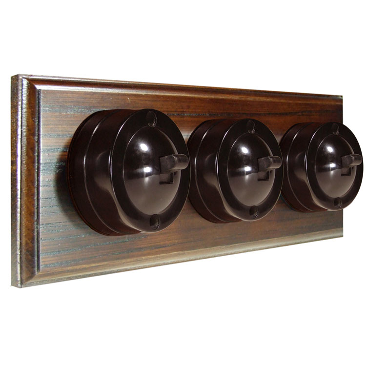 3 Gang Horizontal Bakelite Switch Brown Dolly On A Solid Dark Oak Base