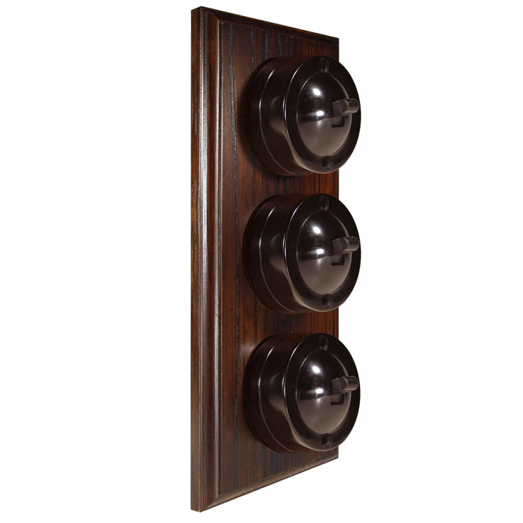 3 Gang Vertical Bakelite Switch Brown Dolly On A Solid Dark Oak Base