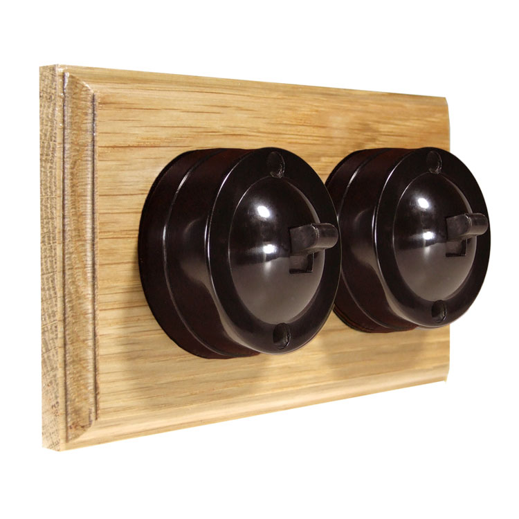 2 Gang Horizontal Bakelite Switch Brown Dolly On A Solid Light Oak Base