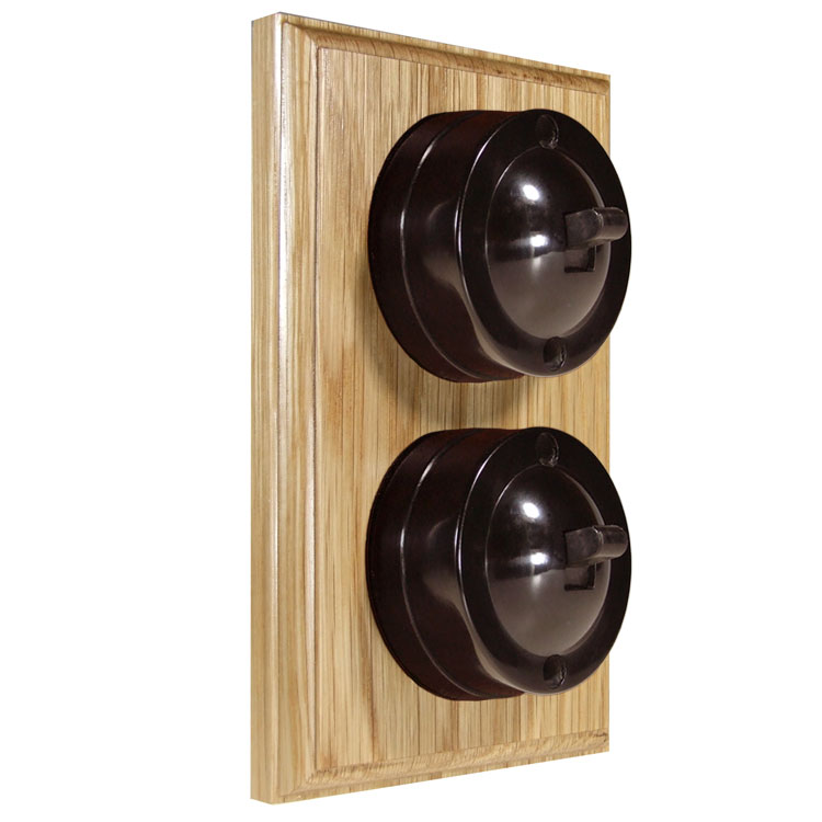 2 Gang Vertical Bakelite Switch, Brown Dolly On A Solid Light Oak Base