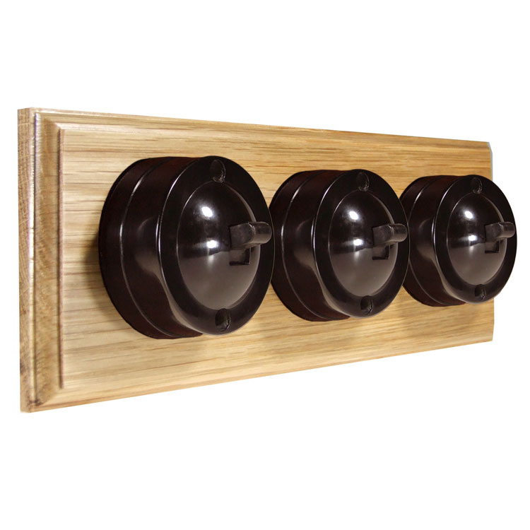 3 Gang Horizontal Bakelite Switch Brown Dolly On A Solid Light Oak Base