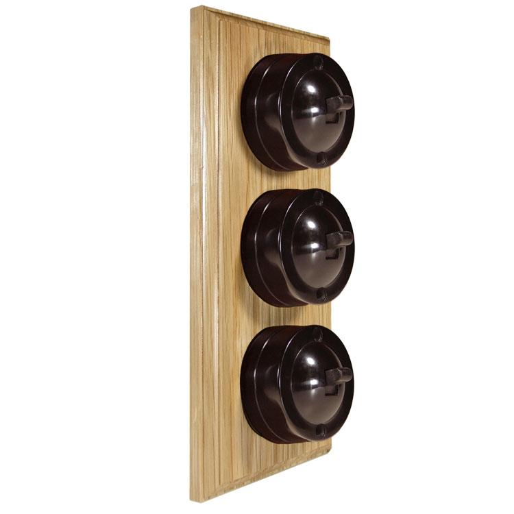 3 Gang Vertical Bakelite Switch Brown Dolly On A Solid Light Oak