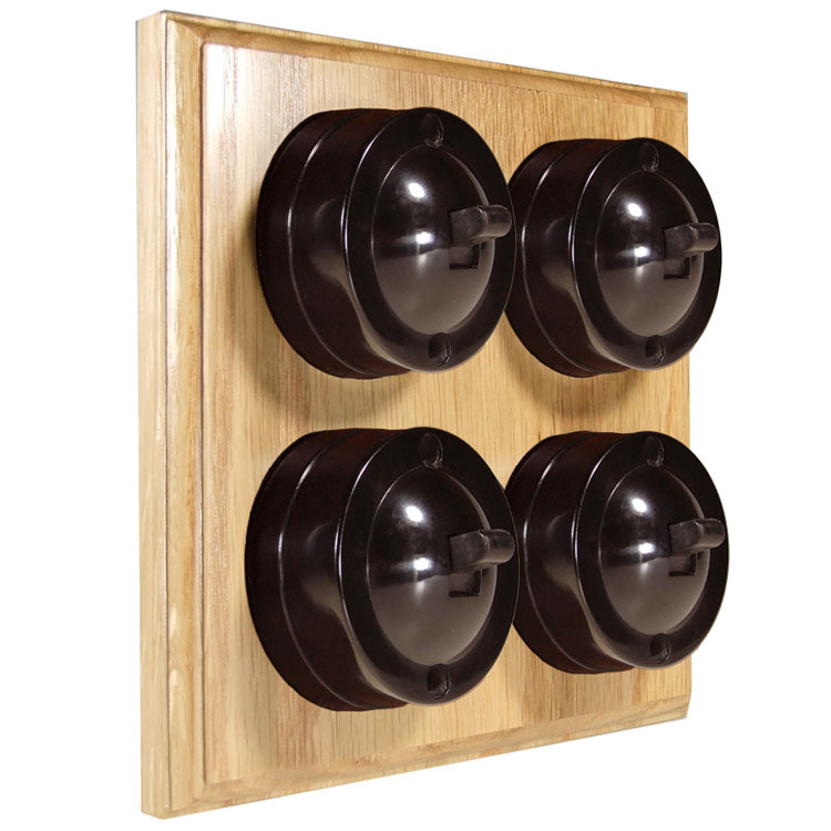 4 Gang Bakelite Switch Brown Dolly On A Solid Light Oak Base