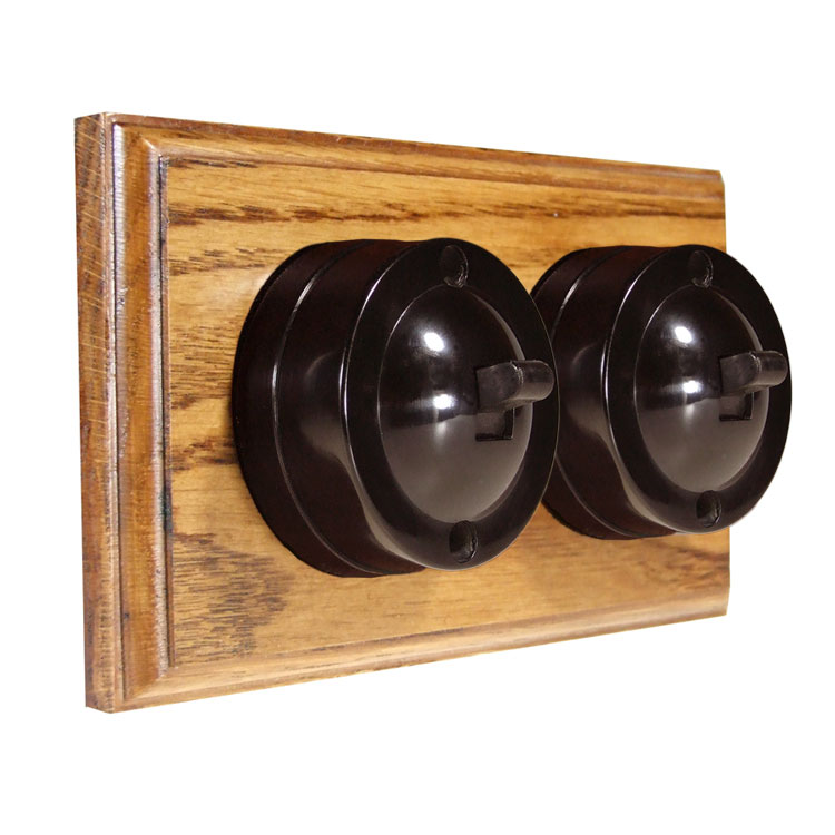 2 Gang Horizontal Bakelite Switch Brown Dolly On A Solid Medium Oak Base