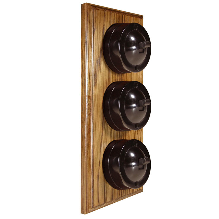 3 Gang Vertical Bakelite Switch Brown Dolly On A Solid Medium Oak Base